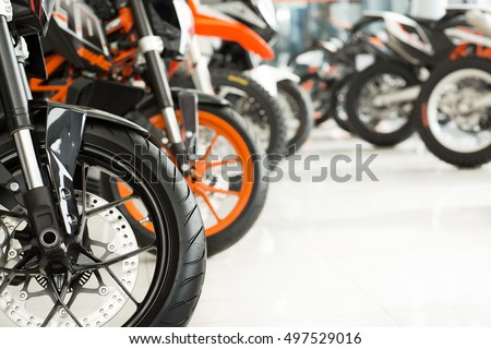 Wide variety. Cropped shot of motorbikes on an exhibition at the motorcycle salon #497529016