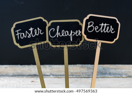 Business message Faster, Cheaper, Better written with chalk on wooden mini blackboard labels, defocused chalkboard and wood table in background #497569363