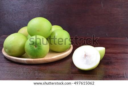 monkey apple on wood table, Thai fruit. #497615062