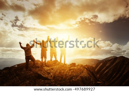 Group of peoples on mountains top in winner pose #497689927