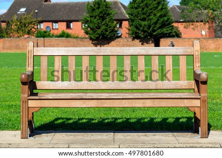 Public wooden bench in a park #497801680