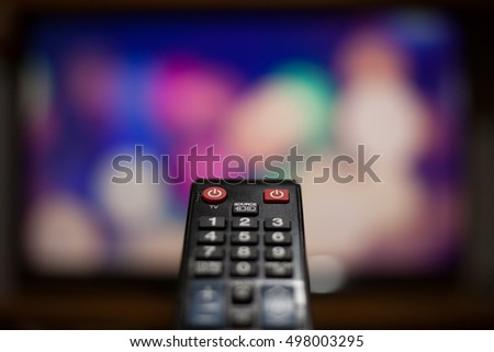 TV remote on the table ( color toned image) #498003295