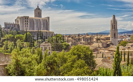 View of the medieval city of Girona with the Cathedral of St. Mary and the Church of St. Feliu, Catalonia, Spain. #498051424