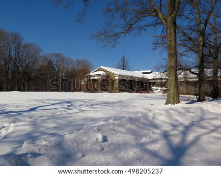 Snow covered grounds of an abandoned psychiatric hospital.  #498205237