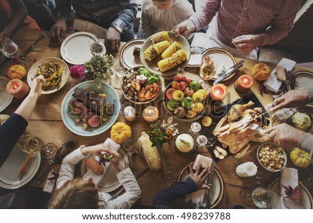 People Celebrating Thanksgiving Holiday Tradition Concept #498239788