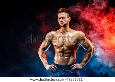 Strong bodybuilder man in military pants with perfect abs, shoulders, biceps, triceps, chest #498567814