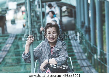 Senior female travelers who are riding on the lift #498663001