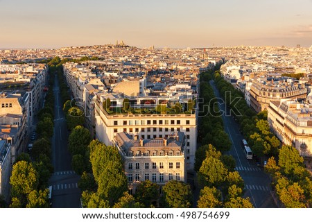 Aerial photo of Paris rooftops with Avenue Hoch and Avenue de Friedland in the 8th arrondissement. Seen in the distance, is the Basilica of The Sacred Heart (8th arrondissement). France #498754699