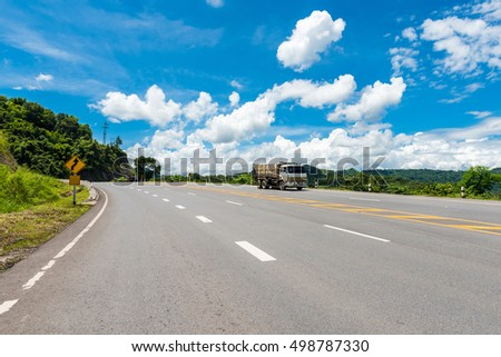 Winding Paved Road with blue sky in the mountain. #498787330