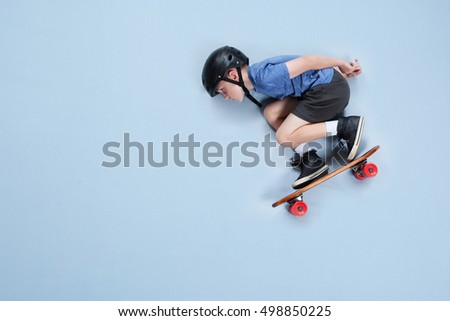 Young athlete on a skateboard Royalty-Free Stock Photo #498850225