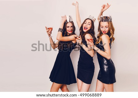 Crazy party time of three  beautiful  stylish  women in elegant casual black outfit  celebrating  new year, birthday , having fun, dancing,drinking alcohol  cocktails .   #499068889