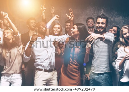 Just dance! Group of beautiful young people dancing together and looking happy #499232479