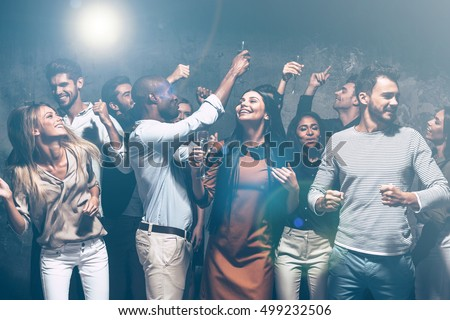 Unstoppable party. Group of beautiful young people dancing together and looking happy #499232506