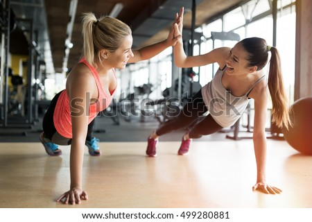Beautiful women working out in gym together Royalty-Free Stock Photo #499280881