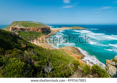 Robberg nature reserve near Plettenberg bay, Garden Route. Wonderful beach and indian ocean waves from above. Robberg peninsula, South african landscape, South Africa, Garden route wilderness  Royalty-Free Stock Photo #499567885