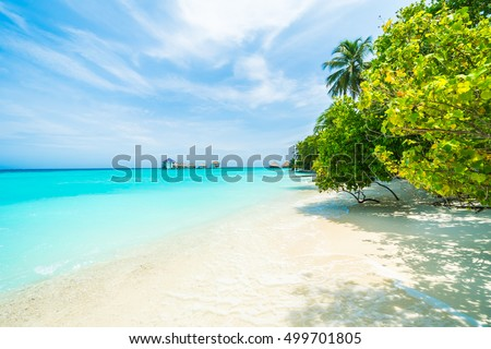 Beautiful tropical Maldives resort hotel and island with beach and sea on sky for holiday vacation background concept - Boost up color Processing #499701805