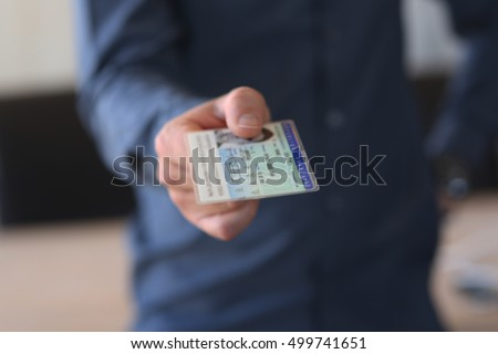Man gives his identity card #499741651