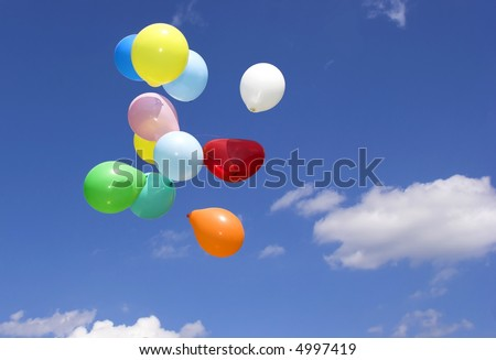 Bunch of party balloons against sky #4997419