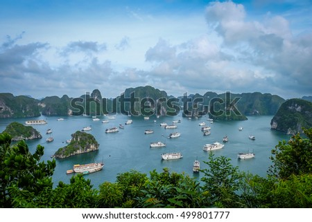 Halong bay boat hotel from top view on ti top Island Royalty-Free Stock Photo #499801777