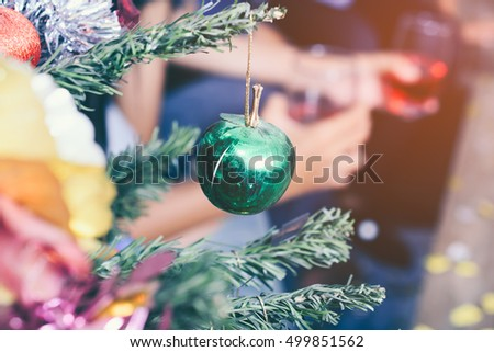 Christmas tree and Christmas decorations with hand holding the glass of red wine background #499851562