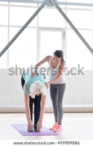 Hard working active woman doing bending exercises #499989886