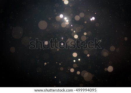 Black abstract bokeh background Royalty-Free Stock Photo #499994095