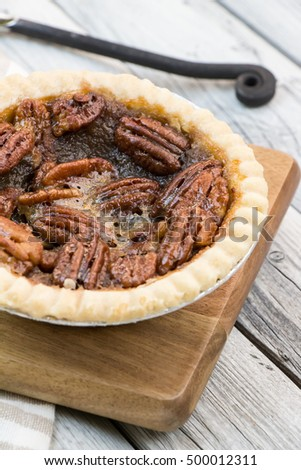 Pecan pie on wooden table. Thanksgiving menu. Wooden table. Rustic style. Pecan tart. #500012311