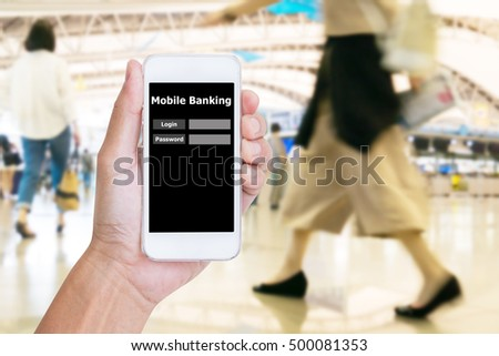 Hand holding mobile phone with Mobile banking application with blur crowd people background #500081353