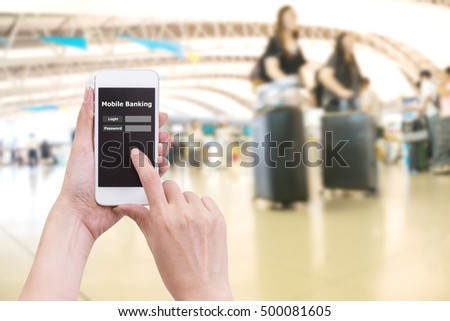 Hand holding mobile phone with Mobile banking application with blur crowd people background #500081605