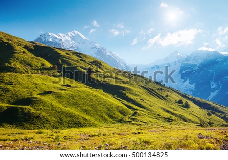 Fantastic snow peaks at the foot of Tetnuldi glacier in the morning light. Picturesque and gorgeous scene. Location place Svaneti, Mestia, Georgia, Europe. High Caucasus ridge. Beauty world. #500134825