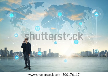 International business concept with businessman on city skyline background with network on map and sunlight #500176117