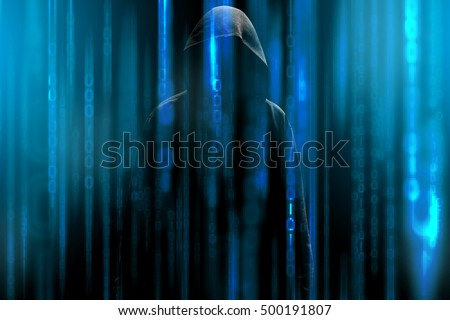 Hacker with a hood and blue binary code matrix. Hacking the confidential secret data. Royalty-Free Stock Photo #500191807
