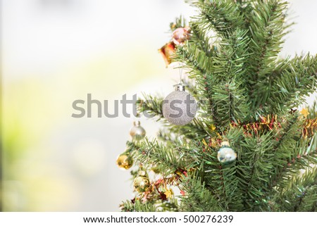 Christmas tree and decorations in the background #500276239