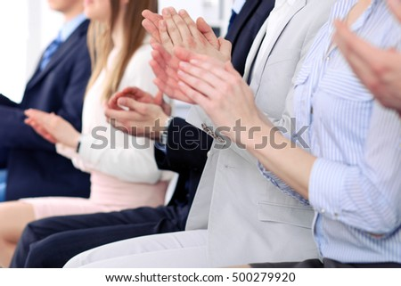 Close up of business people hands  clapping at conference #500279920