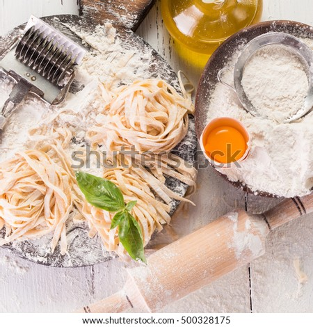 Still life with raw homemade pasta and ingredients for pasta #500328175