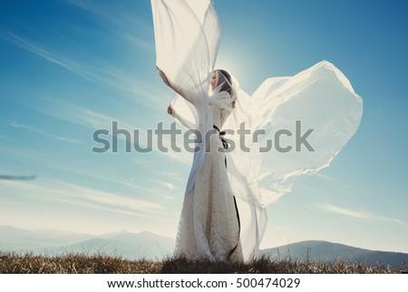 Beautiful stylish bride posing outside #500474029