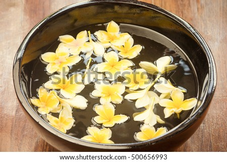 Yellow frangipani flowers floating in the spa bowl #500656993