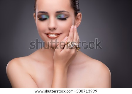 Beautiful woman showing off her jewellery in fashion concept #500713999