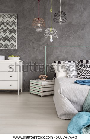Cropped shot of a minimalist bedroom interior with grey walls and white floor #500749648
