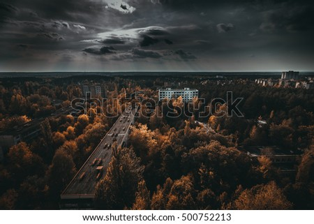 Chernobyl exclusion zone. Ruins of abandoned Pripyat city. Autumn in zone of exclusion. Zone of high radioactivity. Panoramic view of ghost town. Ruins of buildings. Chernobyl. Ukraine. #500752213