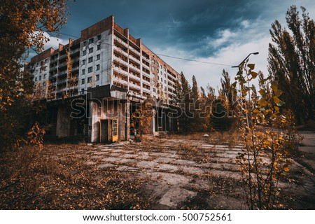 Chernobyl exclusion zone. Ruins of abandoned Pripyat city. Autumn in zone of exclusion. Zone of high radioactivity. Panoramic view of ghost town. Ruins of buildings. Chernobyl. Ukraine. #500752561