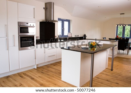 An brand new open plan kitchen and dining area in a large contemporary property #50077246