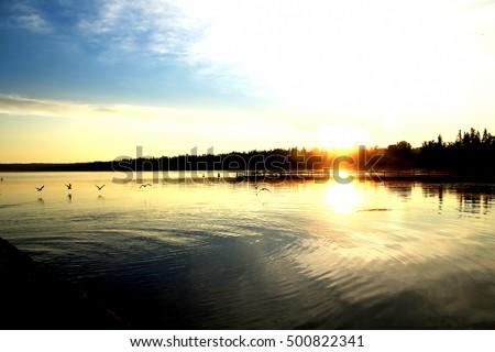 Tranquil dawn at Wasksiu Lake in Prince Albert National Park in Saskatchewan Canada