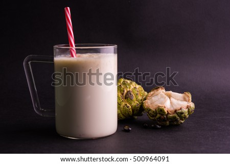 Custard Apple / Sitafal Milk Shake served in a glass with whole fruit over moody background. Selective focus #500964091