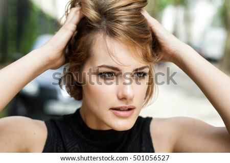 Young beautiful girl brushing her hair through with her fingers. #501056527