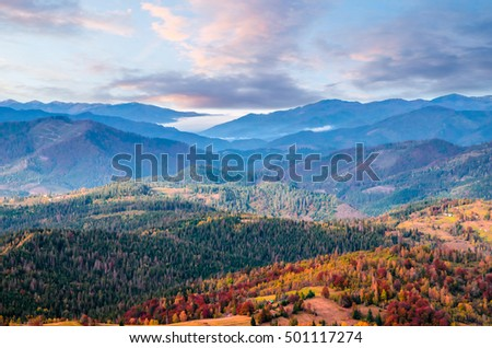 Colorful autumn landscape with mountain peaks at the sunset #501117274