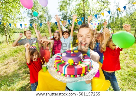 Portrait of smiling girl holding birthday cake #501157255