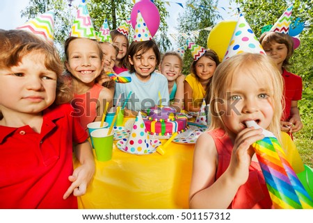 Happy kids having fun with party whistles #501157312