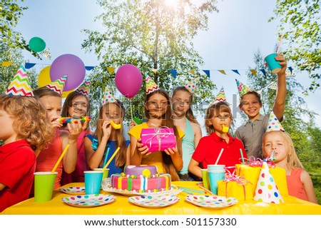 Funny kids cheering birthday girl at summer park #501157330