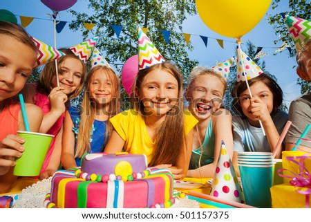 Big group of smiling kids around birthday cake #501157375